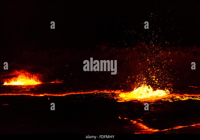 Lava bubbles burst on the surface of the Erta Ale lava lake, Ethiopia - Stock Image