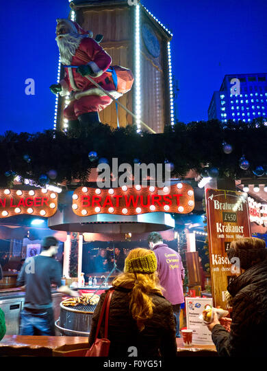 German Christmas market food stall illuminated at night South Bank London UK - Stock Image