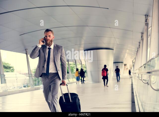 Businessmen Walk Call Phone Luggage Business Trip - Stock Image