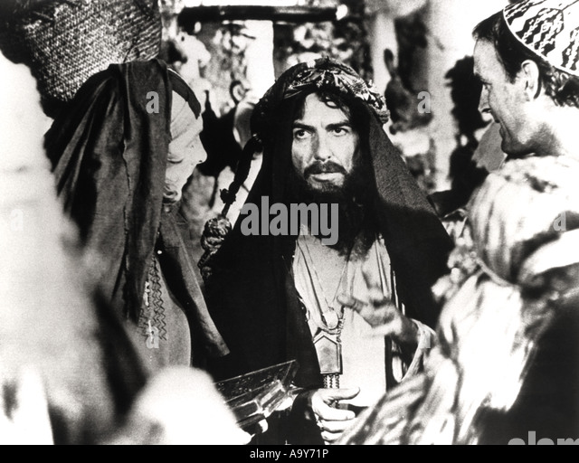 MONTY PYTHON'S  LIFE OF BRIAN - 1979 Hand Made film with George Harrison centre and John Cleese at right - Stock Image