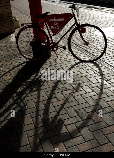 Welcome to Warrington Bank Quay Railway Station, Cheshire, England UK bike in shadow - Stock Image