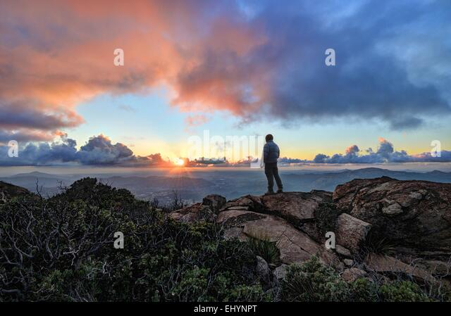Mature man standing on a mountain at sunset, Cleveland National Forest, USA - Stock Image