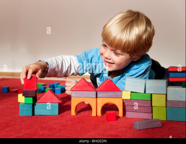 boy with toy building blocks - Stock Image