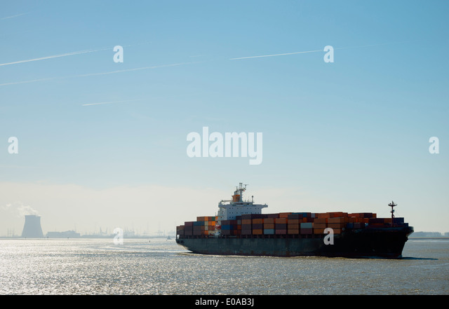 Container ship leaving Antwerp harbor, Belgium - Stock-Bilder