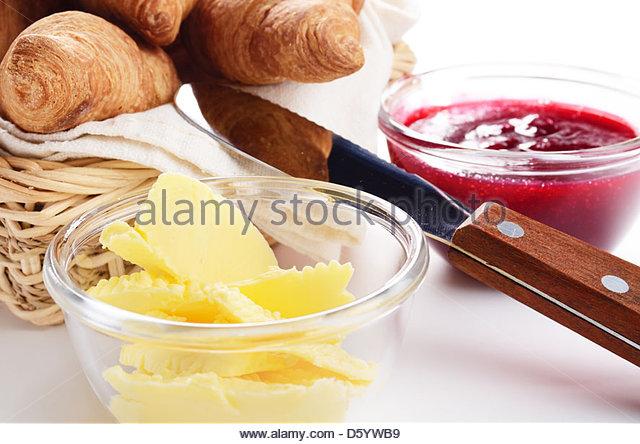 Croissants, jam and butter - Stock-Bilder