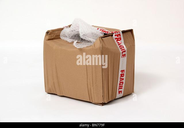 Damaged fragile parcel - Stock Image