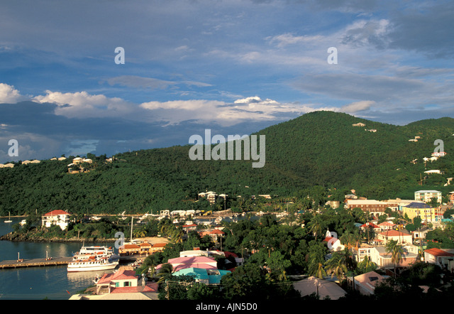 St John  united states US Virgin Islands Cruz Bay at twilight architecture buildings green mountain scenic landscape - Stock Image