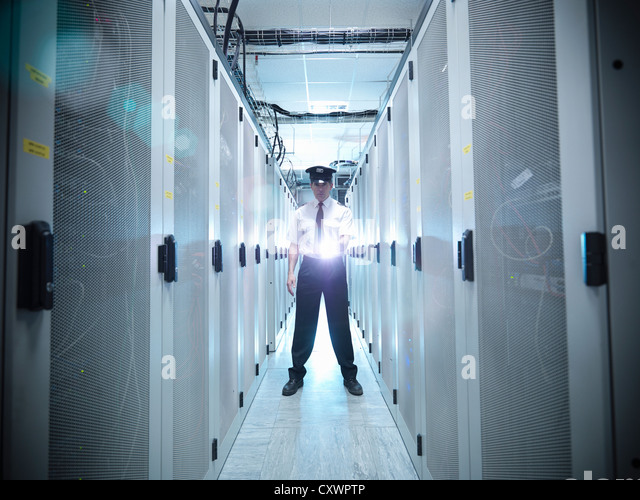 Security guard in server room - Stock Image