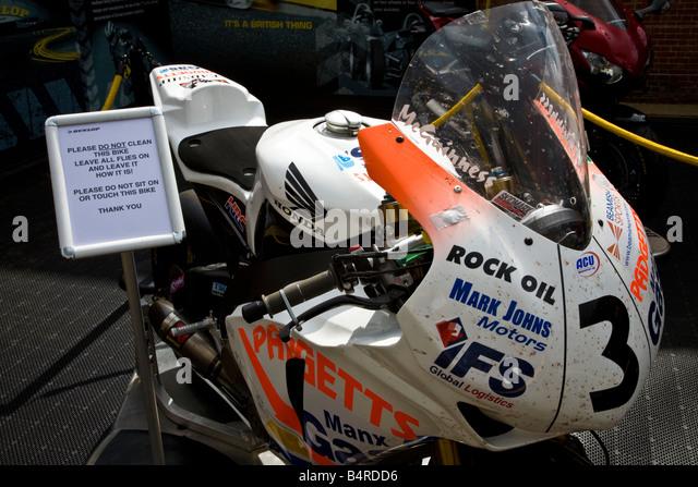 Sign beside the 2008 Isle of Man TT winning Honda CBR600RR of John McGuinness at Goodwood Festival of Speed, Sussex, - Stock Image