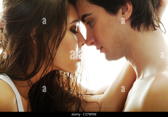 Portrait of young couple face to face - Stock-Bilder