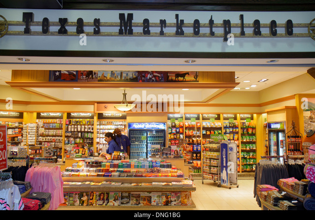 Texas Houston George Bush Intercontinental Airport IAH terminal concourse gate area shopping Texas Marketplace convenience - Stock Image