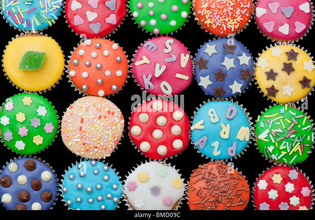 Colourful mini cupcakes on a black background - Stock-Bilder