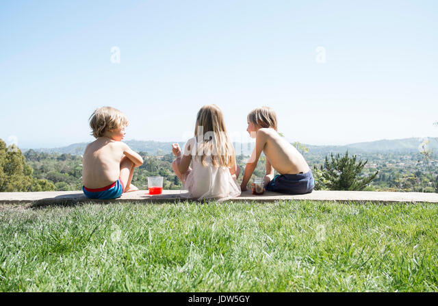 Rear view of children having picnic - Stock-Bilder