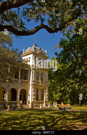 Lawn gardens building Steves Homestead museum is a historic house built 1876 San Antonio River San Antonio Texas - Stock Image