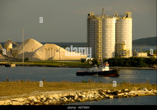 Tampa Bay Florida  Port of Tampa tug boat storage tank towers open space text space copy space type space - Stock Image
