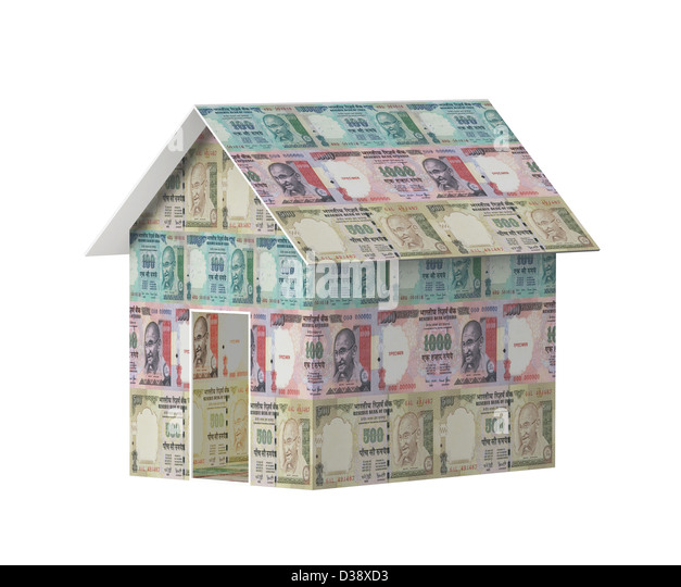 Close-up of a model home covered with rupees - Stock Image