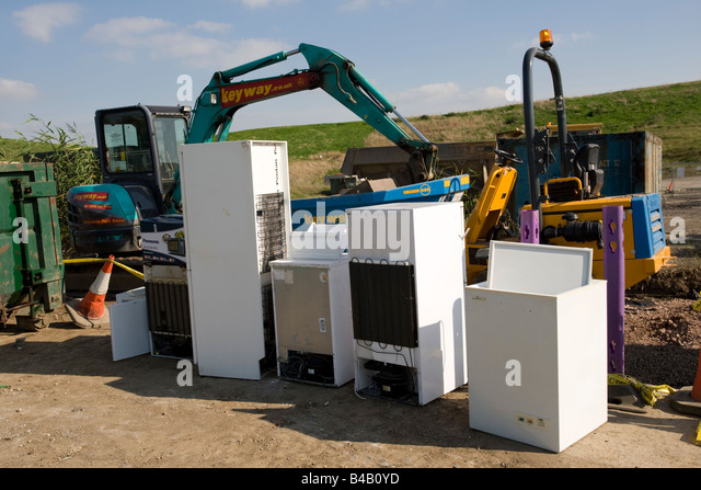 Domestic fridges awaiting recycling site Wingmoor Farm Stoke Orchard Cheltenham UK - Stock Image