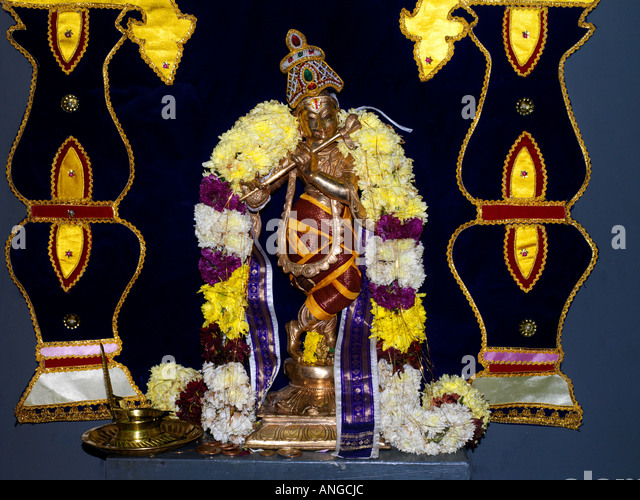 Murugan Tamil Temple New Malden Surrey England Lord Krishna and Offerings - Stock Image