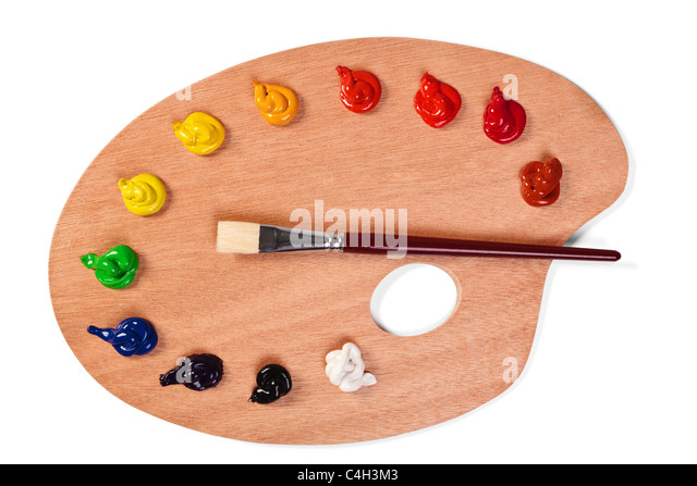 Photo of a wooden artists palette loaded with various colour paints and brush, isolated on a white background with - Stock Image