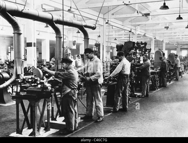 Industrial workers at their workplaces, 1934 - Stock-Bilder