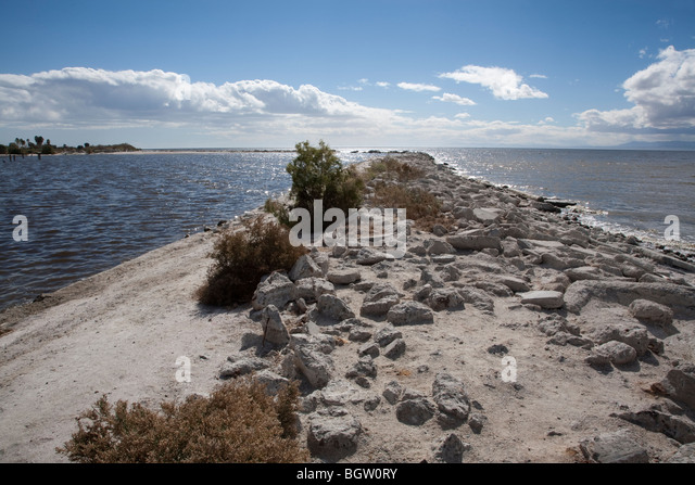 Rocky peninsula jutting out into the Salton Sea in Southern California. - Stock Image