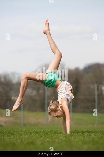 Austria, Teenage girl doing gymnastics - Stock Image