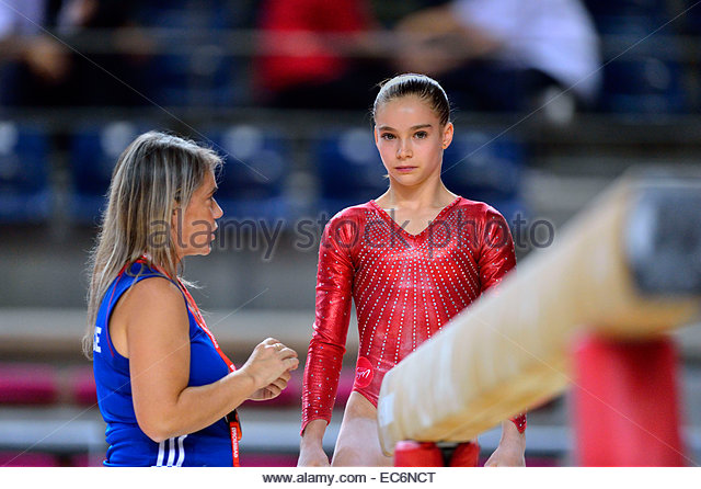 French gymnast Leanne BOURGEOIS in action at the beam in the Elite Gym Massilia at the Palais Des Sports Marseille. - Stock Image