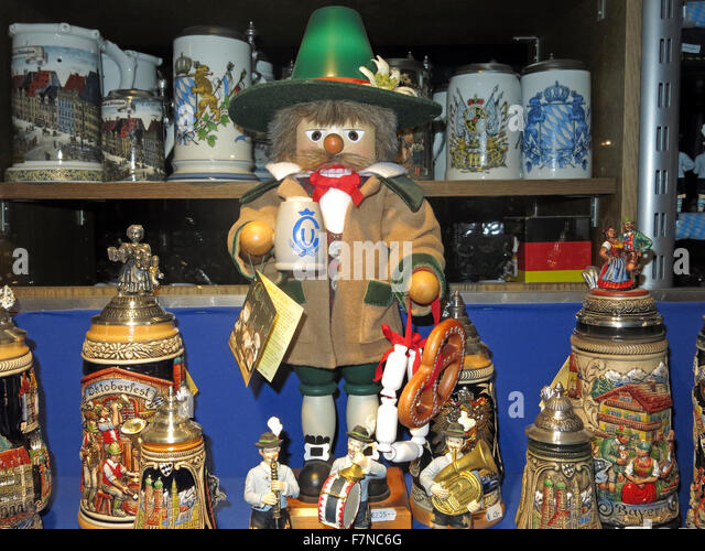 Oktoberfest shop window display, Munich,Germany; Steins, dolls, T-shirts and other souvenirs - Stock Image