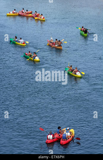 Canoeing on the Gard River below the Pont Du Gard , Gard, Languedoc-Roussilon, France, Europe - Stock Image