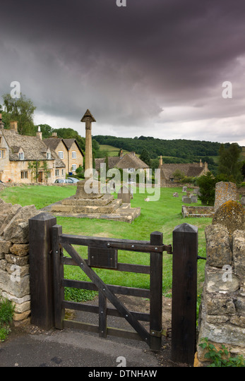 St Barnabus church graveyard and cottages in the pretty Cotswolds village of Snowshill, Worcestershire, England. - Stock Image