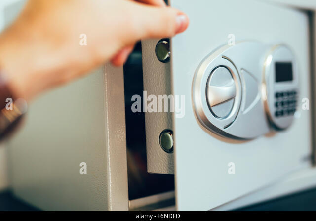 Opening of a safe where money is deposited - Stock Image