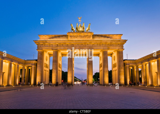 Brandenburg gate Pariser Platz with the winged Quadriga statue on top at sunset Berlin city centre Germany EU Europe - Stock-Bilder