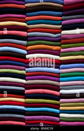 Peruvian Alpaca sweaters stacked in a colorful pile - Stock Image
