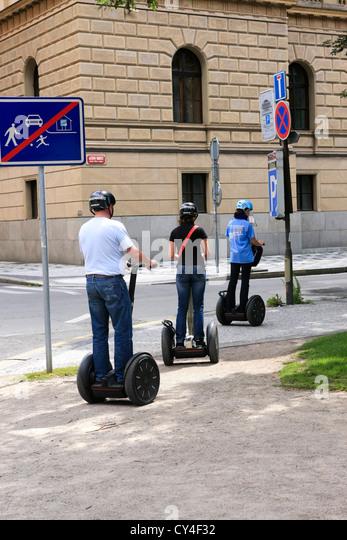 Female tourist sightees around Prague on a segway - Stock Image