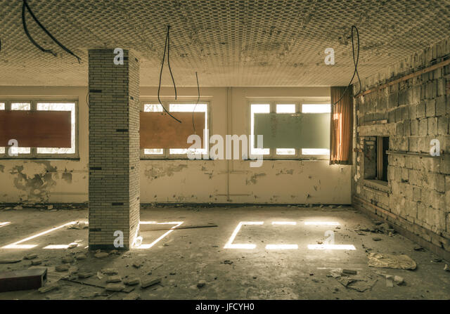 decayed room with safe windows - Stock Image