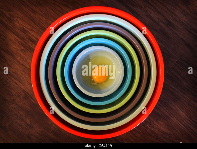 Egg in Colorful Bowls - Stock Image