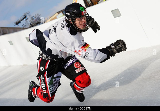 A competitor skates in the Red Bull Crashed Ice competition during the international shoot-out and elimination round. - Stock Image