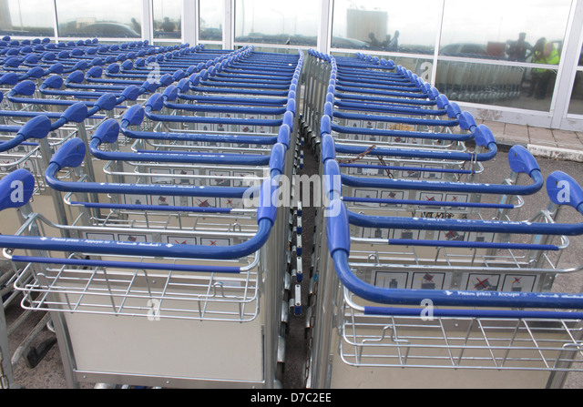 Baggage Trolley chained together at the front of remodeled Murtala Muhammed International Airport Terminal, Lagos, - Stock Image