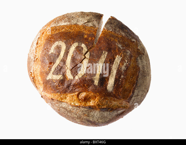 round loaf of bread dusted with a year date - Stock Image