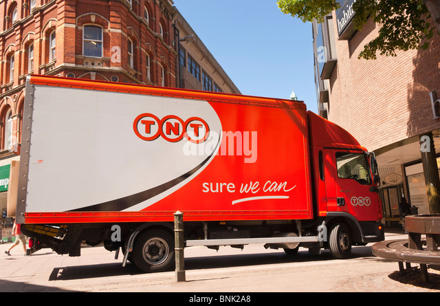 A TNT courier van lorry vehicle in Norwich , Norfolk , England , Great Britain , Uk - Stock Image