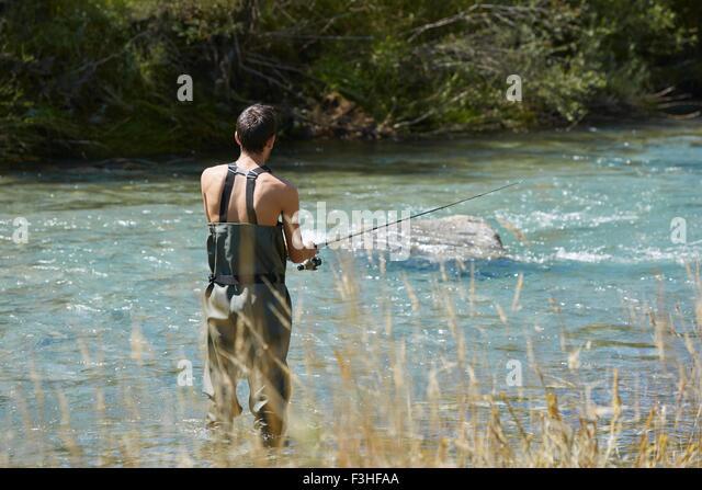 Man fishing at stream, Asturias, Spain - Stock Image