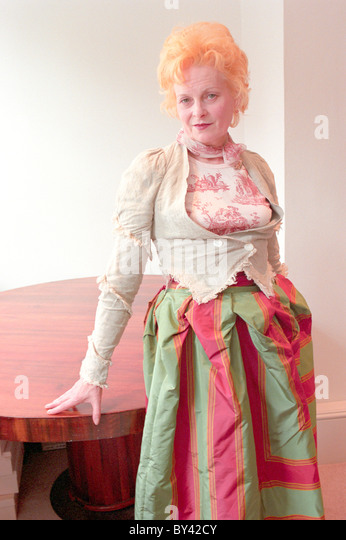 The fashion designer Vivienne Westwood modeling her own clothing range at her office in Soho London - Stock Image