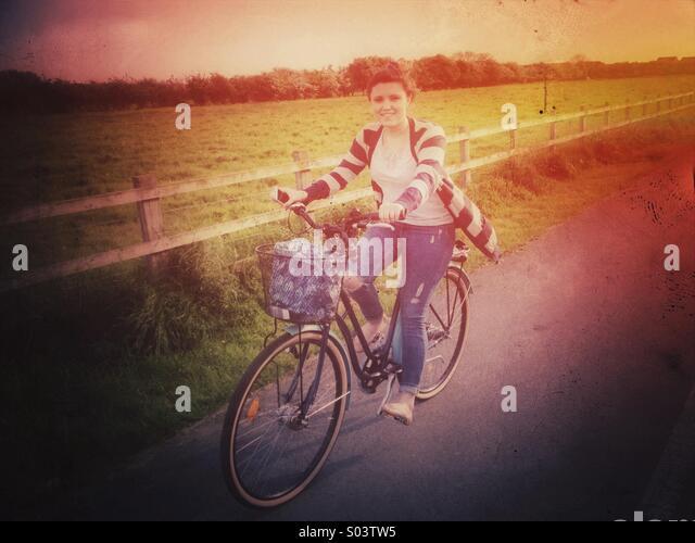 Girl on retro style bike - Stock Image
