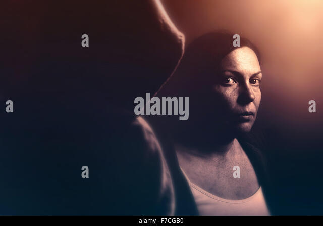 Stalker concept, intense low key portrait of woman being stalked, retro toned image with selective focus - Stock-Bilder