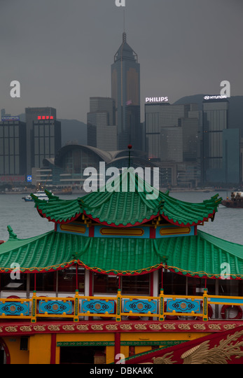 Hong Kong Harbour skyline scene tourists tourism - Stock Image