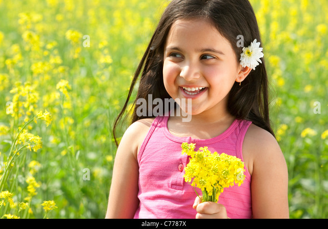 Young girl holding flowers - Stock Image