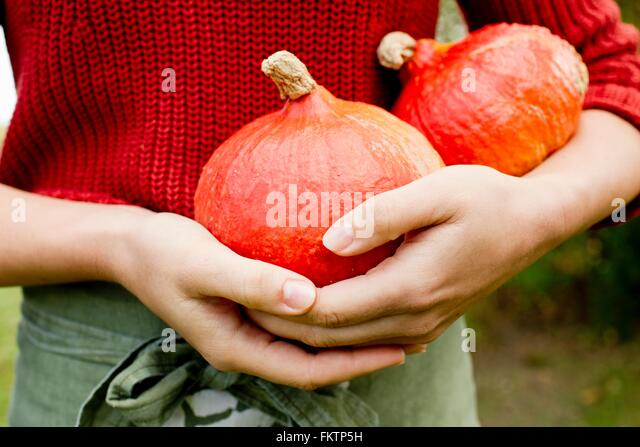 Woman holding homegrown squash - Stock Image
