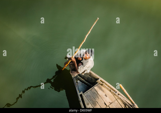 Boatman on the Ganges, Varanasi India - Stock-Bilder