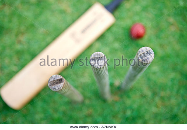 Cricket bat stumps and ball focus on foreground overhead view - Stock Image