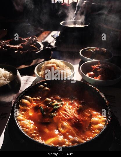 Soondubu, Korean hot tofu stew, served boiling hot with pachan and galbi at a Korean restaurant in New Jersey , - Stock Image